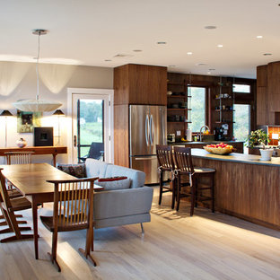 Contemporary eat-in kitchen inspiration - Eat-in kitchen - contemporary u-shaped light wood floor and beige floor eat-in kitchen idea in Boston with an undermount sink, flat-panel cabinets, medium tone wood cabinets, brown backsplash, wood backsplash, stainless steel appliances, a peninsula and gray countertops