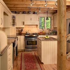 Rustic Kitchen by Katahdin Cedar Log Homes
