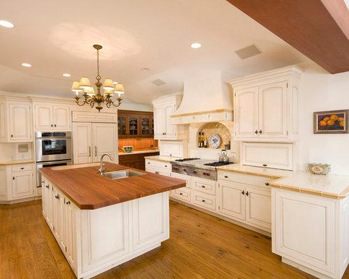 cuisine avec un lectrom nager encastrable et un plan de travail en carrelage photos et id es. Black Bedroom Furniture Sets. Home Design Ideas