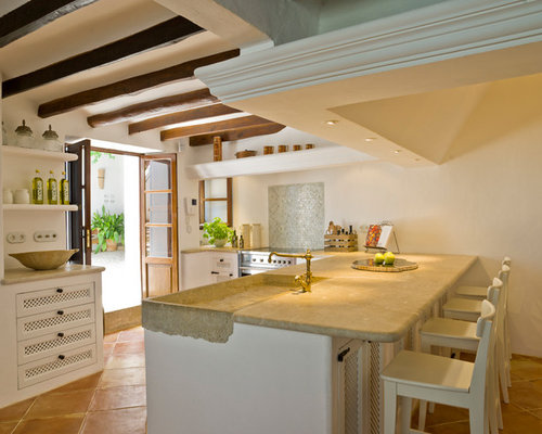 Example Of A Tuscan Terra Cotta Floor Kitchen Design In London With An Integrated Sink