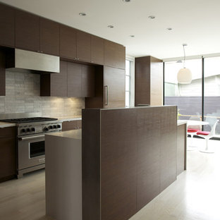 Minimalist Galley Eat In Kitchen Photo In San Francisco With Flat Panel  Cabinets,