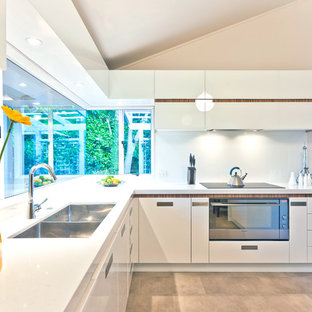 Mid-sized modern kitchen photos - Kitchen - mid-sized modern l-shaped porcelain floor and beige floor kitchen idea in Los Angeles with a double-bowl sink, flat-panel cabinets, white cabinets, quartz countertops, white backsplash, glass sheet backsplash, stainless steel appliances and no island
