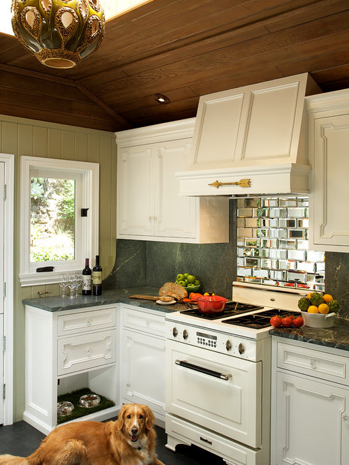 Eclectic Kitchen Idea In Los Angeles With White Appliances And Mirror  Backsplash