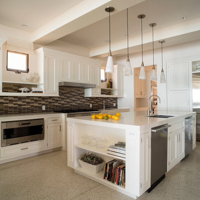 Example of a transitional kitchen design in Los Angeles with a double-bowl sink, recessed-panel cabinets, white cabinets, multicolored backsplash, matchstick tile backsplash and stainless steel appliances