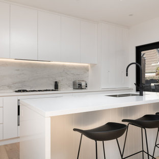 This is an example of a contemporary galley open plan kitchen in Melbourne with with island.