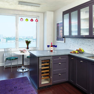 Eclectic eat-in kitchen photos - Inspiration for an eclectic l-shaped dark wood floor eat-in kitchen remodel in New York with an undermount sink, purple cabinets, multicolored backsplash, a peninsula and glass-front cabinets