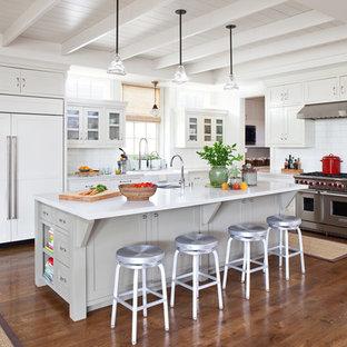 Coastal kitchen appliance - Beach style u-shaped kitchen photo in Los Angeles with an undermount sink, recessed-panel cabinets, white backsplash, subway tile backsplash and paneled appliances