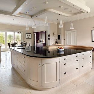 Eat-in kitchen - contemporary eat-in kitchen idea in Kent with shaker cabinets and white cabinets