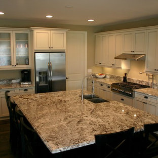 Example of a large transitional l-shaped dark wood floor eat-in kitchen design in Denver with an undermount sink, shaker cabinets, white cabinets, granite countertops, stainless steel appliances and an island