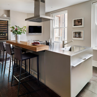 Example of a trendy kitchen design in Cheshire with an island
