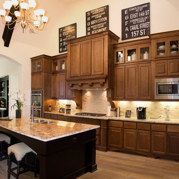 Maple cabinets with medium stain and large custom wood range hood