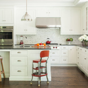 Inspiration for a large timeless l-shaped dark wood floor kitchen remodel in New York with an undermount sink, shaker cabinets, white cabinets, granite countertops, multicolored backsplash, stainless steel appliances and an island