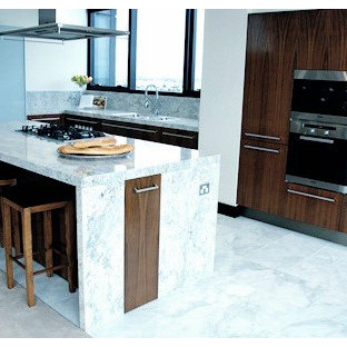 This is an example of a mid-sized galley open plan kitchen in Melbourne with dark wood cabinets, marble benchtops, grey splashback, stone slab splashback, marble floors, with island and green floor.