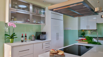 Marble Waterfall Counters and a Floating Range Hood