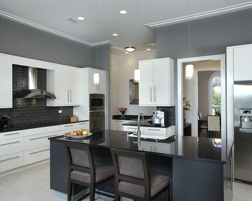 Mid Sized Trendy U Shaped Kitchen Photo In Miami With Stainless Steel Appliances