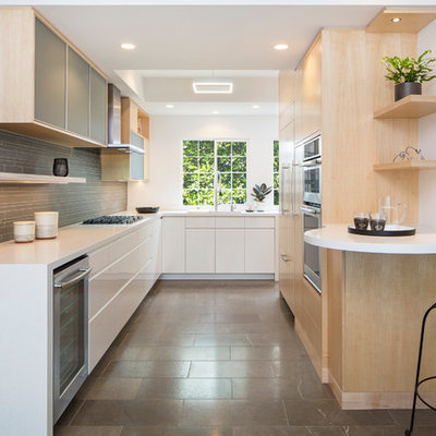 Kitchen - contemporary u-shaped kitchen idea in Los Angeles with an undermount sink, flat-panel cabinets, light wood cabinets, gray backsplash, matchstick tile backsplash, stainless steel appliances, a peninsula and white countertops