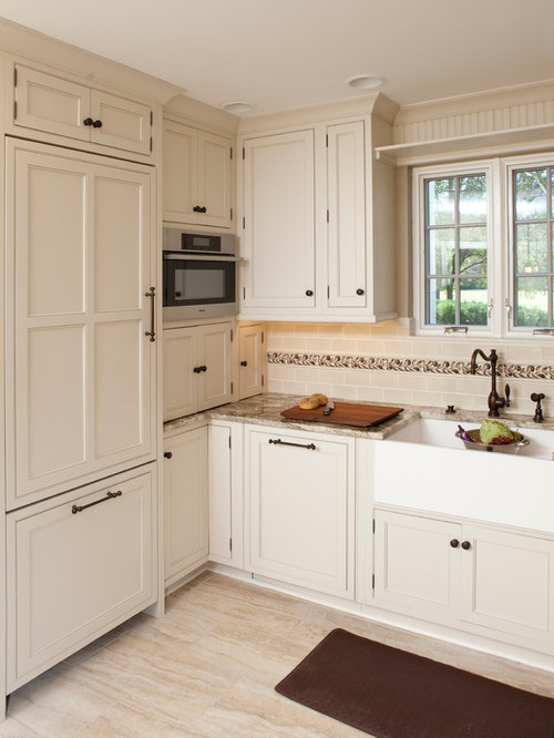 Inspiration For A Timeless Beige Floor Kitchen Remodel In Cincinnati With A  Farmhouse Sink, Beaded