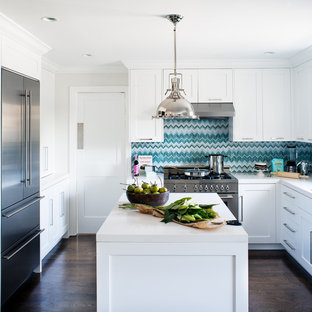 Kitchen - contemporary l-shaped kitchen idea in San Francisco with stainless steel appliances, shaker cabinets, white cabinets and quartz countertops