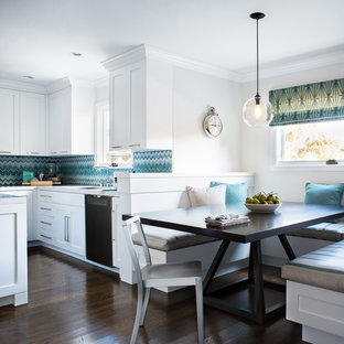 This is an example of a contemporary kitchen/diner in San Francisco with shaker cabinets, white cabinets and blue splashback.