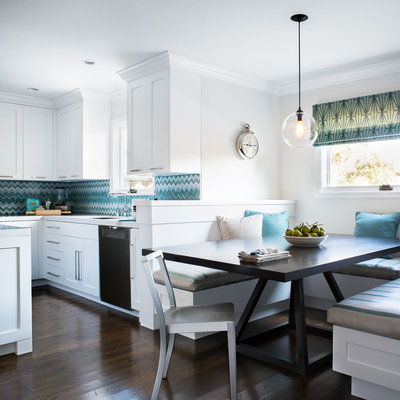 Trendy eat-in kitchen photo in San Francisco with shaker cabinets, white cabinets and blue backsplash