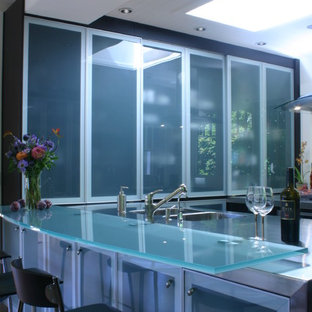 Contemporary kitchen designs - Trendy kitchen photo in Other with glass countertops and turquoise countertops