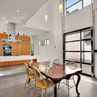 Example of an urban eat-in kitchen design in Seattle with flat-panel cabinets and medium tone wood cabinets