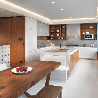 Example of a minimalist l-shaped eat-in kitchen design in San Francisco with open cabinets, medium tone wood cabinets, gray backsplash, paneled appliances and an undermount sink