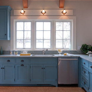 Inspiration for a beach style kitchen remodel in Boston with shaker cabinets, blue cabinets, marble countertops and stainless steel appliances