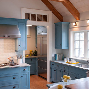 Beach style kitchen photo in Boston with an undermount sink, shaker cabinets, blue cabinets, marble countertops, white backsplash and glass tile backsplash