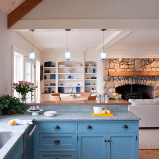 Example of a beach style open concept kitchen design in Boston with beaded inset cabinets, blue cabinets and marble countertops