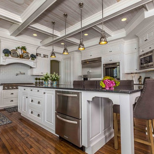 Kitchen - traditional kitchen idea in Seattle with stainless steel appliances and subway tile backsplash