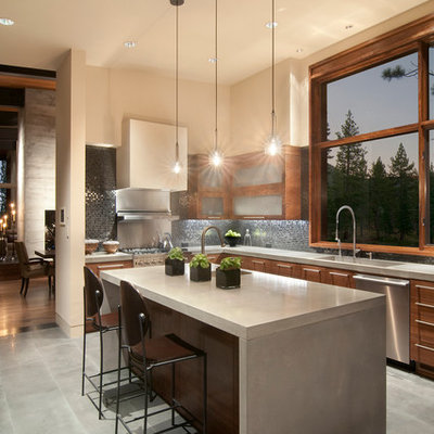 Example of a trendy kitchen design in Sacramento with flat-panel cabinets, dark wood cabinets, black backsplash, mosaic tile backsplash, stainless steel appliances, concrete countertops and an integrated sink