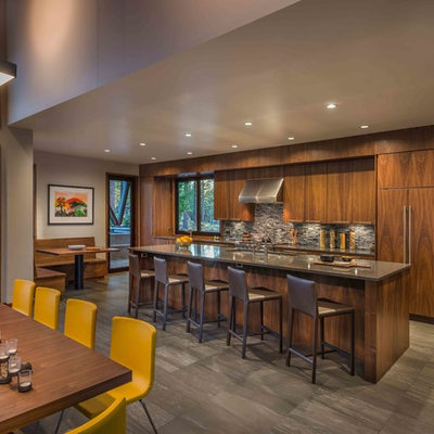 Example of a mountain style galley eat-in kitchen design in Sacramento with flat-panel cabinets, dark wood cabinets, gray backsplash, mosaic tile backsplash and an island