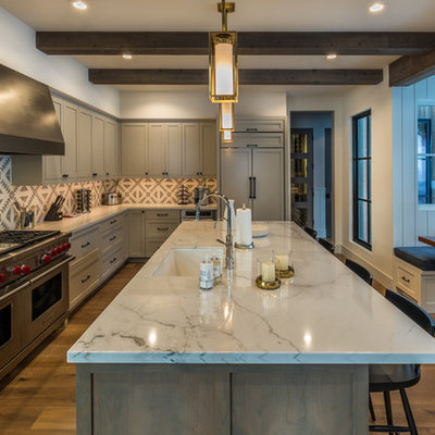 Eat-in kitchen - mid-sized farmhouse l-shaped medium tone wood floor and brown floor eat-in kitchen idea in Sacramento with shaker cabinets, gray cabinets, marble countertops, an island, an undermount sink, gray backsplash and paneled appliances