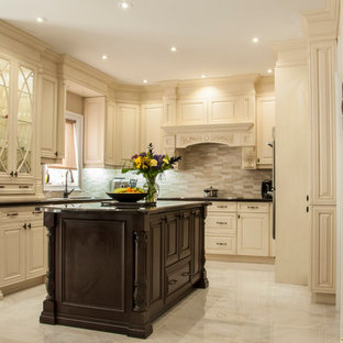 Design ideas for a medium sized classic u-shaped kitchen/diner in Toronto with a submerged sink, raised-panel cabinets, beige cabinets, granite worktops, multi-coloured splashback, matchstick tiled splashback, stainless steel appliances, marble flooring, an island, grey floors and black worktops.