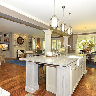 Mid-sized craftsman eat-in kitchen inspiration - Example of a mid-sized arts and crafts l-shaped dark wood floor and brown floor eat-in kitchen design in Baltimore with a farmhouse sink, recessed-panel cabinets, gray cabinets, terrazzo countertops, white backsplash, ceramic backsplash, stainless steel appliances and an island