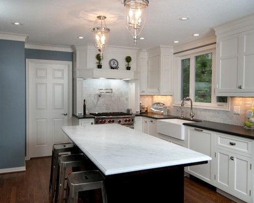 Traditional L Shaped Kitchen Idea In Portland With Stainless Steel  Appliances, A Farmhouse Sink