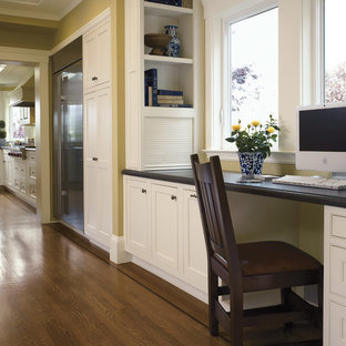 Elegant kitchen photo in San Francisco with white cabinets and stainless steel appliances