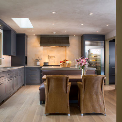 Inspiration for a mediterranean l-shaped eat-in kitchen remodel in DC Metro with concrete countertops, stainless steel appliances, shaker cabinets and blue cabinets