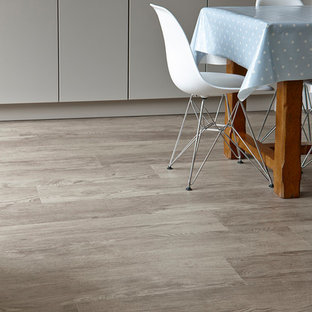 Inspiration for a rustic kitchen in Sussex with vinyl flooring.