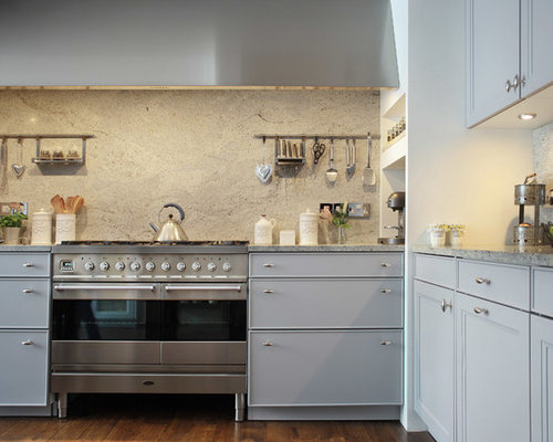 Inspiration For A Transitional Kitchen Remodel In London With Granite Countertops Gray Cabinets Stone