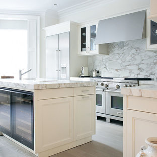 Example Of A Trendy Kitchen Design In London With Stainless Steel Liances White Backsplash And
