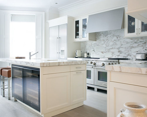 Example Of A Trendy Kitchen Design In London With Stainless Steel Appliances White Backsplash And
