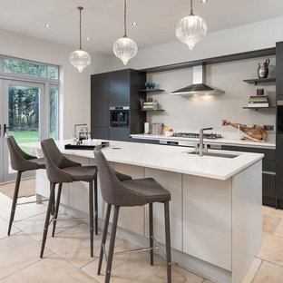 This is an example of a contemporary kitchen in Other with an integrated sink, flat-panel cabinets, solid surface benchtops, stainless steel appliances, with island and yellow benchtop.