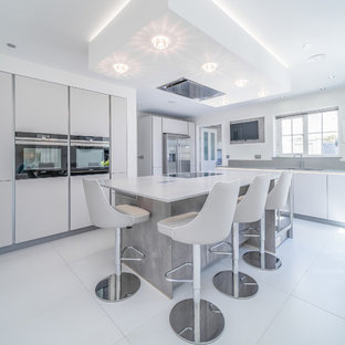 Mid-sized contemporary kitchen in Essex with an integrated sink, grey cabinets, quartzite benchtops, concrete floors, with island, white floor and yellow benchtop.
