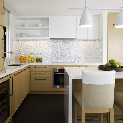 Inspiration for a contemporary kitchen remodel in Hawaii with white backsplash, flat-panel cabinets and light wood cabinets