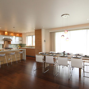 Example of a minimalist galley eat-in kitchen design in Hawaii with flat-panel cabinets and light wood cabinets