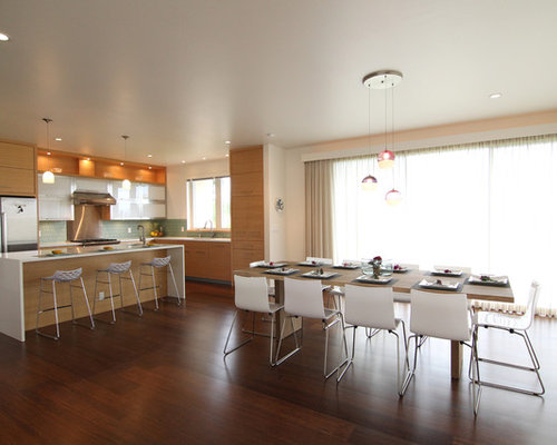 Example Of A Minimalist Galley Eat In Kitchen Design In Hawaii With  Flat Panel