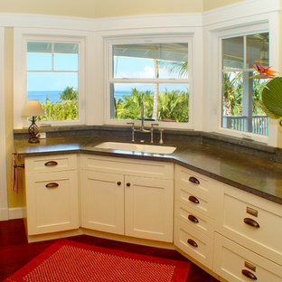 Photo of a beach style kitchen in Hawaii with limestone benchtops.