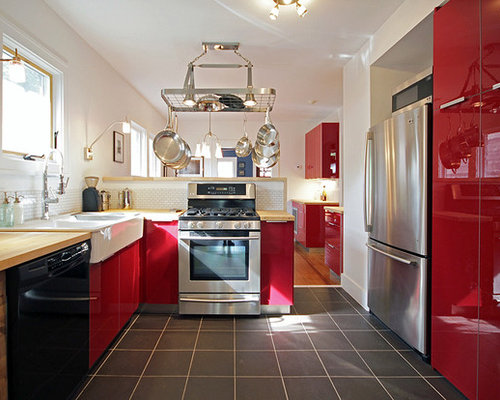Inspiration for a large farmhouse galley slate floor and black floor  enclosed kitchen remodel in Houston